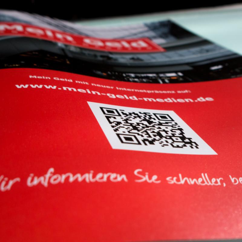 rote Anzeige mit QR Code und Bild Wirtschaftsmagazin Mein Geld